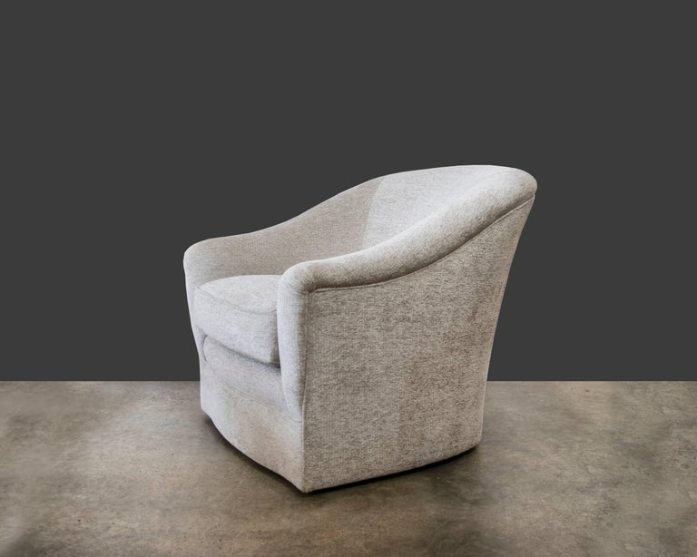 Donghia Swivel Chair Upholstered In Luxurious Cream
