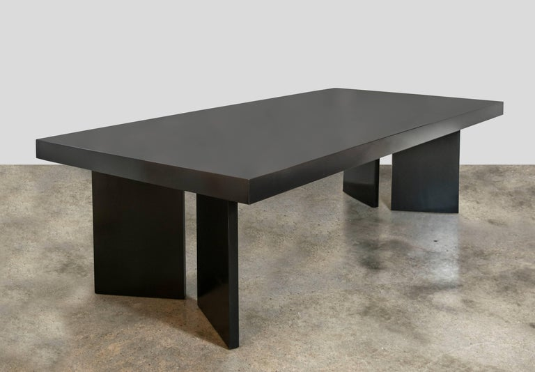 Gorgeous custom mahogany dining table from the 1950s. Ebonized lacquered finish with V-shaped pedestal leg supports. One solid 8 foot long piece, very well constructed. Lacquer finish is glass-like and exquisite.