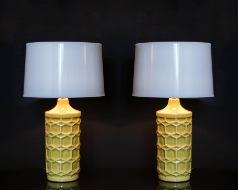 Wonderful pair of matte gold/yellow ceramic honeycomb lamps. These lamps are sure to add a bright spot of color to any room.