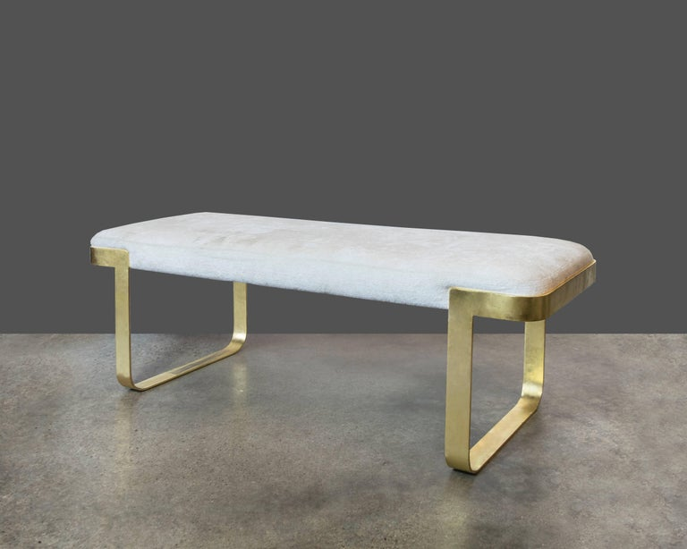 Perfect size entryway or end of bed bench in gold-plated metal and off-white chenille upholstery. A few scratches here and there but otherwise in really good vintage condition.