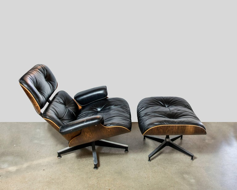 A much coveted original rosewood and black leather vintage Eames chair by Herman Miller from the 1970s. As these chairs age throughout the years, they need rubber bumpers / shocks which are easily available and found on Ebay or Herman Miller.