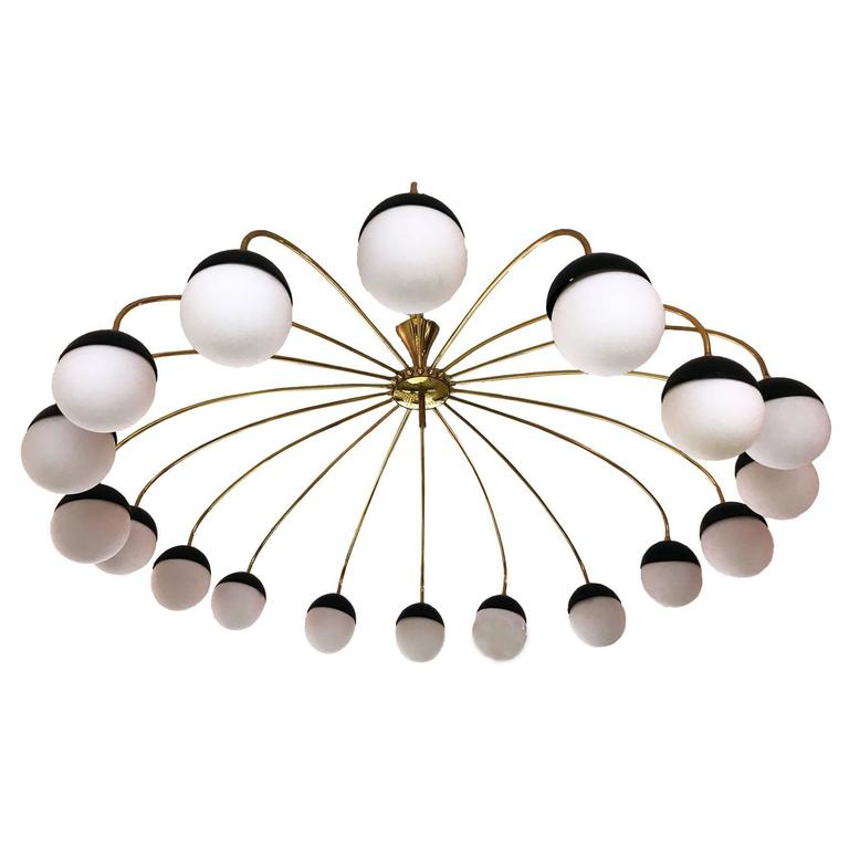 Gorgeous 1960s Stilnovo style 18-arm Italian chandelier with glass globes, brass structure and metal lacquered black cups.
