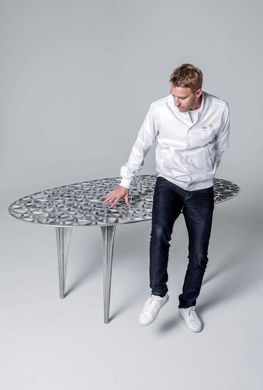 A polished aluminium dining table inspired by the infamous red rocks of Sedona; the form references the peaks and plateaus of Sedona's unique sandstone formations. This design has a strong Silhouette and delicate, organic triangular