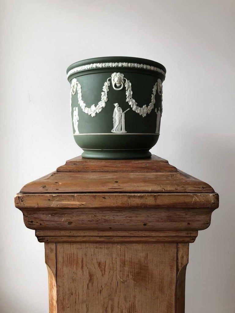 Wedgwood dark olive green Jasper Jardiniere or garden pot features the bas-reliefs of 5 of the 9 Muses. The Muses, the personification of knowledge, literature, dance and music, were the nine daughters of Zeus. Modeled by John Flaxman in