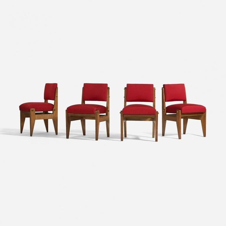 A rare design, in the spirit of Jean Prouve: Dining chairs, set of four, designed by Robert Guillerme and Jacques Chambray; stained oak, upholstery; France, circa 1950.  Dimension: 22