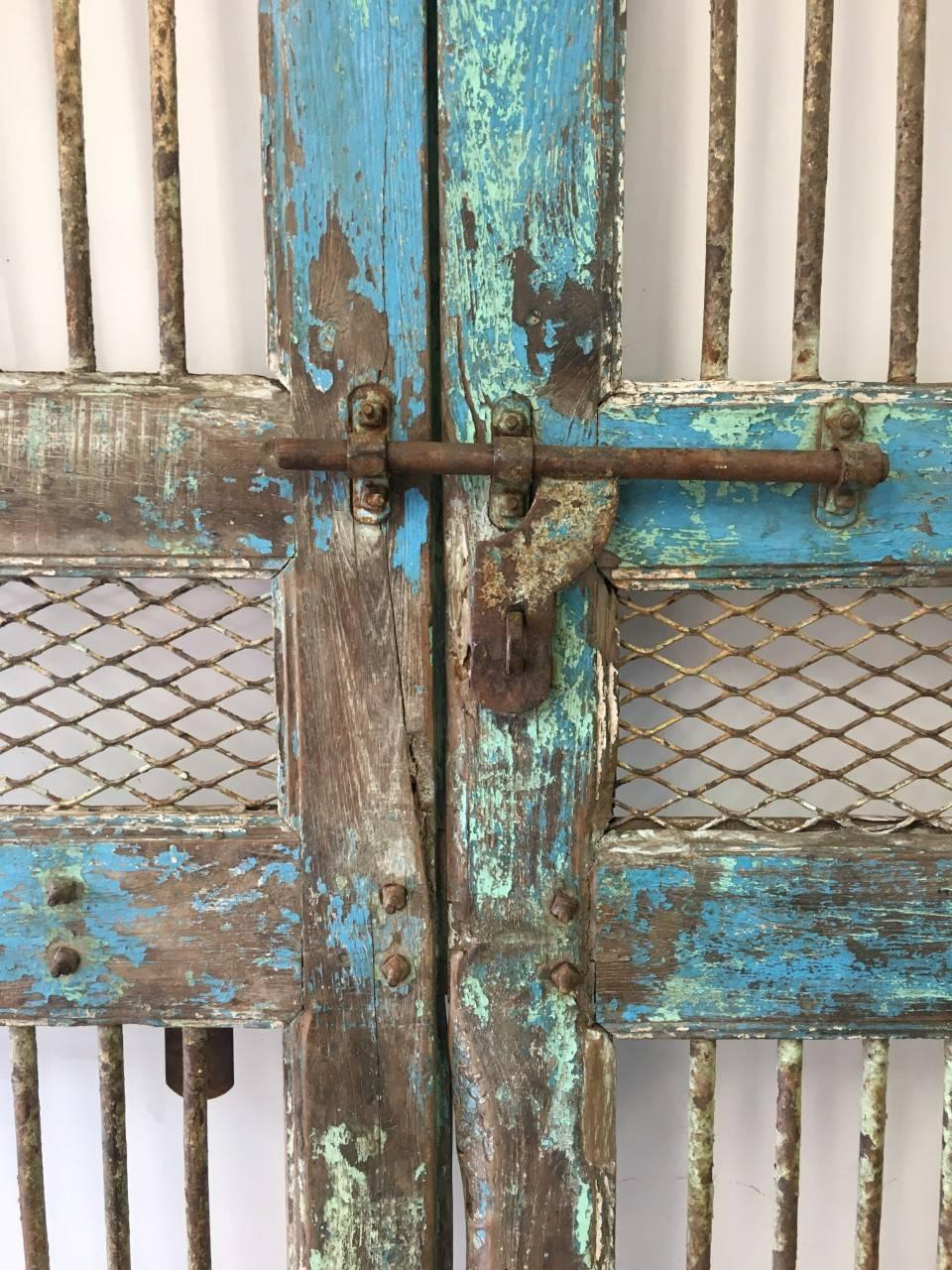 Pair of painted gated doors early to mid 20th Century India. Beautiful naturally & Pair of Painted Gated Doors India For Sale at 1stdibs