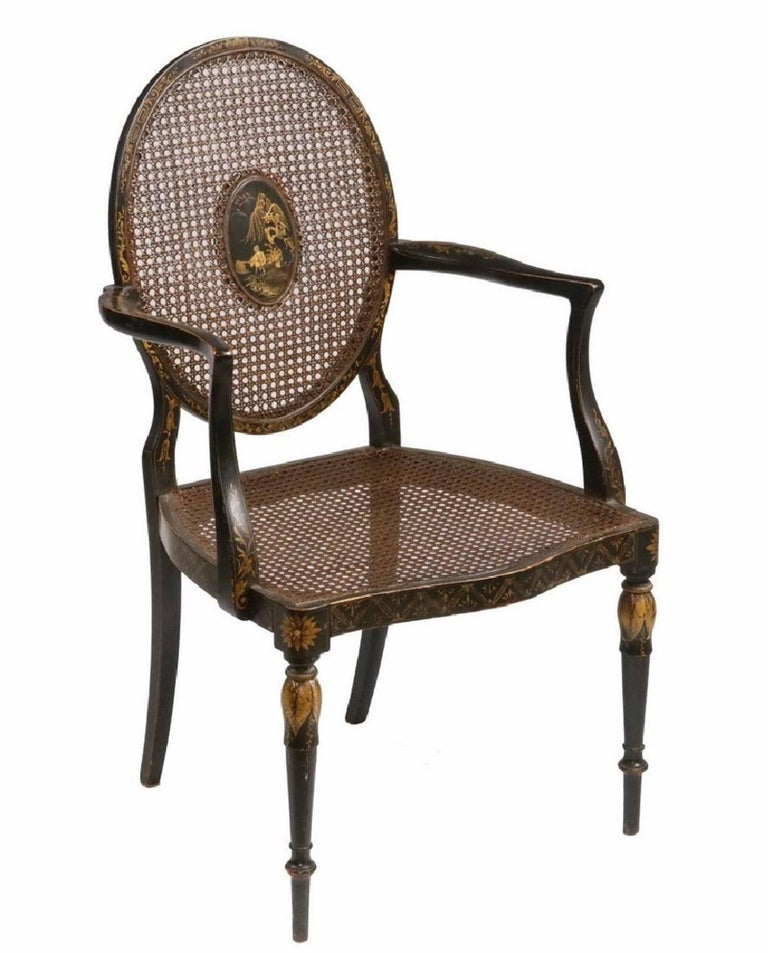 19th century English black lacquered chinoiserie armchair, caned seat and back, centre medallion.