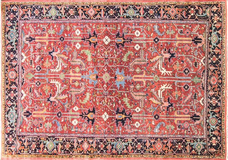 A great painting is measure by beauty of its colors and the same statement goes for this rug. Heriz rugs are Persian rugs from the area of Heriz, East Azerbaijan in Northwest Iran, Northeast of Tabriz. Such rugs are produced in the village of the