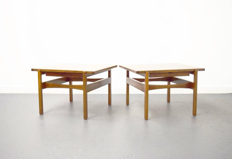 Pair of Jens Risom end / side tables. Surface floats on sculptural frame. Hidden drawer with dovetailing detail.