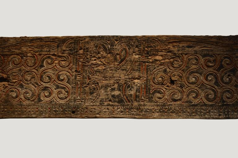 Andrianna Shamaris hand-carved architectural panel from Toraja. The carving symbolizes peace and happiness. Originally used as an exterior panel.  Andrianna Shamaris, Inc. The Leader In Modern Organic Design™