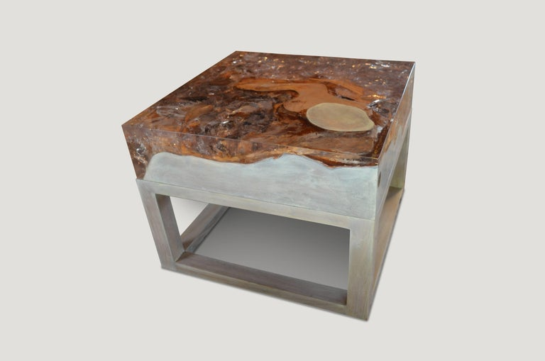 This Cracked Resin side table or coffee table is made from reclaimed teak infused with clear resin, which resembles a unique quartz crystal with many different facets, as shown here with gold, warm tones created naturally from the wood. Straight