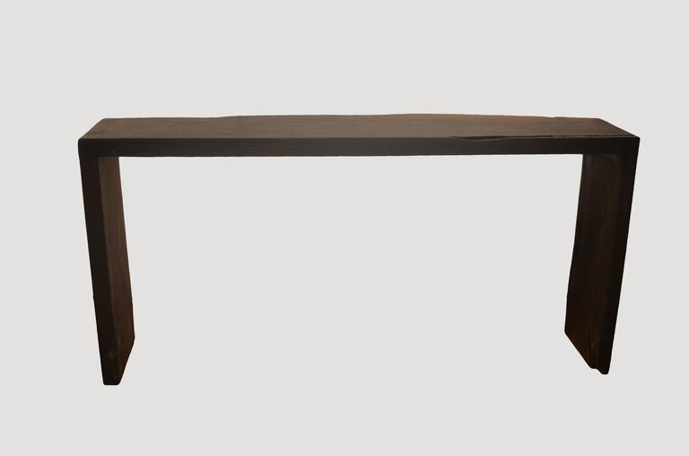 Burnt one time to produce this beautiful dark brown color with many different under tones. The top and legs are made from a single 2″ thick reclaimed teak slab.  72″ long x 15- 19″ wide x 34″ high.  Andrianna Shamaris. The Leader In Modern Organic