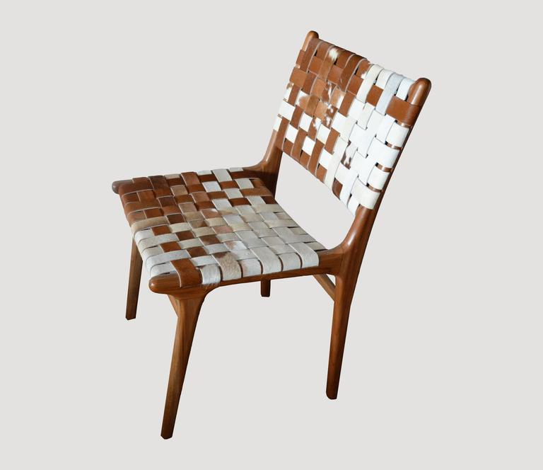 premium double backed teak wood cowhide chair for sale at 1stdibs