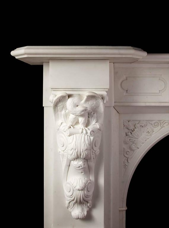 Impressive mid-19th century carved statuary marble fireplace. The fireplace has a deep and moulded break fronted shelf, upheld by two large carved corbels with perched eagles, preening themselves. The centre plaque depicts Zeus with his trident, in