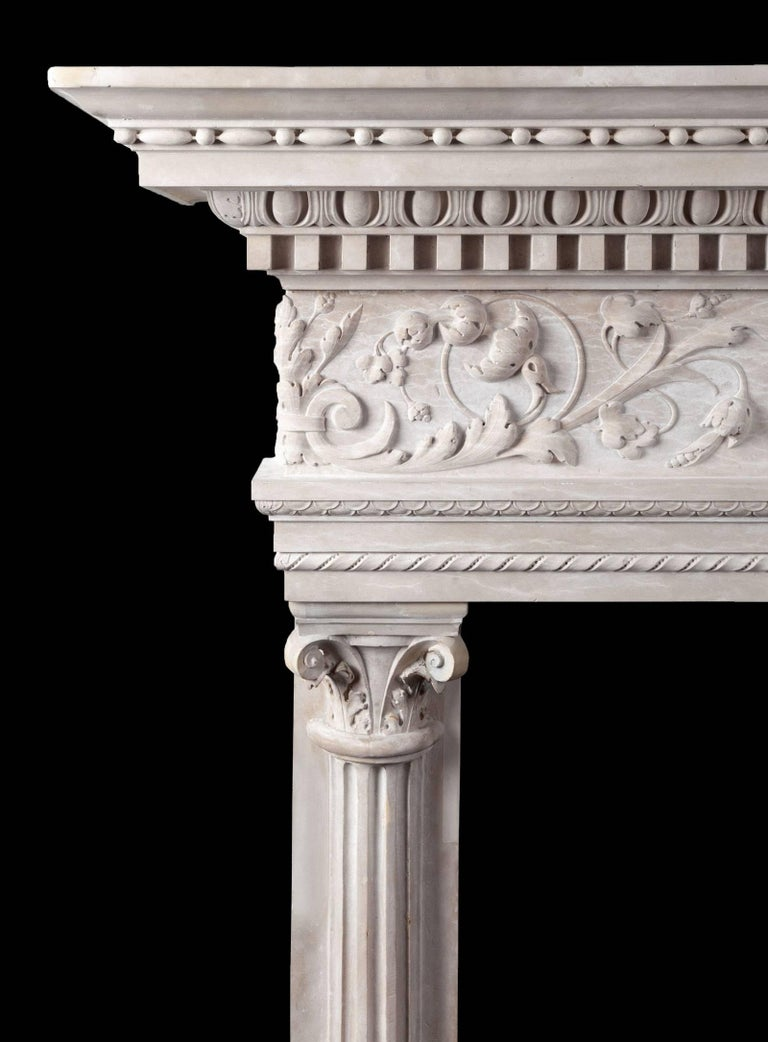 An Italian, Venetian mantelpiece in the Renaissance style, carved in Pietra d'Istria marble, sometimes called Istrian stone. The deep shelf, with its front edges carved with dental, egg and dart and bead and reed motifs, rests on a very fine