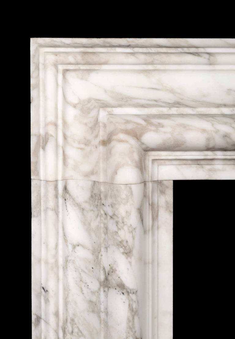 A large bolection fireplace surround of generous proportions . The substantial 12? (300mm) wide bolection moulded frame, rests on plain square plinths.