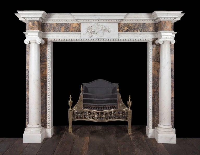 An exceptional Irish George III Sienna and statuary marble mantelpiece. The breakfront shelf decorated with leaf-work and egg and dart mouldings, this above a Sienna marble frieze centred by an exquisitely carved tablet. The centre tablet depicts a