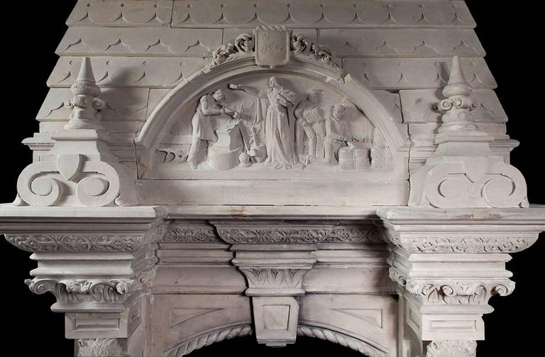 Each jamb of the fireplace has a brown bear standing on a plinth holding a heraldic shield. Above the bears are carved capitals supporting a substantial breakfront cornice shelf. The overmantel section of the fireplace has two large finials centred