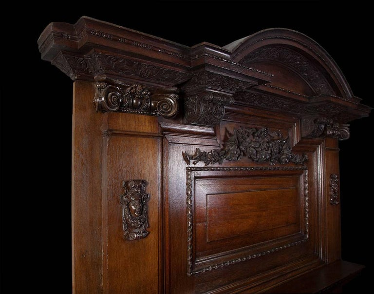 Antique Baroque style carved oak fireplace of large-scale.