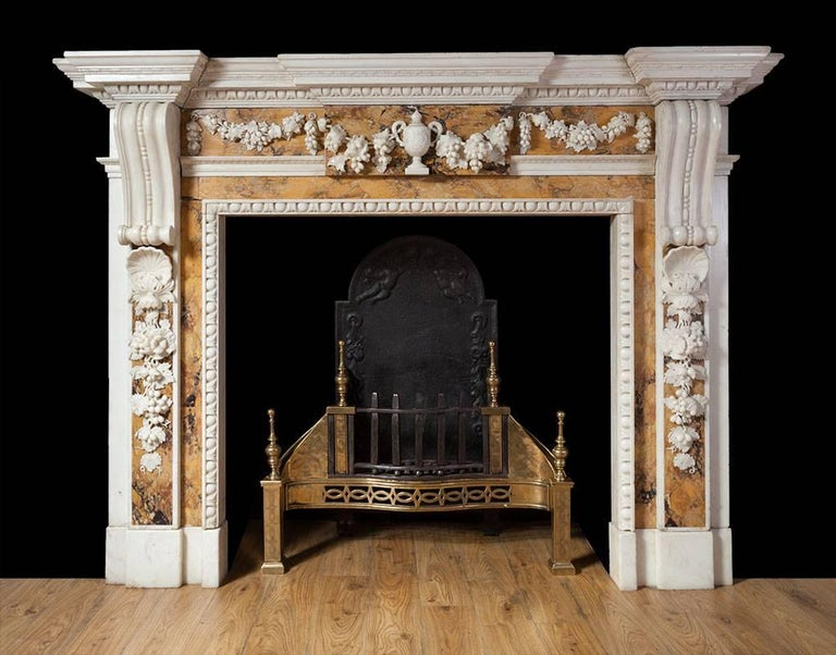 A magnificent George II statuary and Sienna marble fireplace, in the manner of British scupture