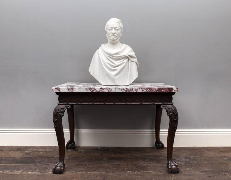 Antique statuary Carrara marble bust depicting a male in the classical Roman portrait style. Life-sized and beautifully carved in the purest of white statuary marble. 