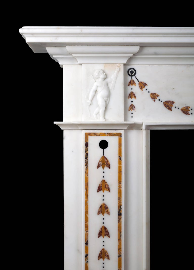 An antique Irish 18th century neoclassical marble fireplace of fine quality. The very well sculpted centre tablet depicts the three cupids: the first cupid was the son of Mercury and Diana, the second of Mercury and Venus, and the third of Mars and