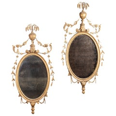 Pair of Carved Giltwood Neoclassical Oval Mirrors