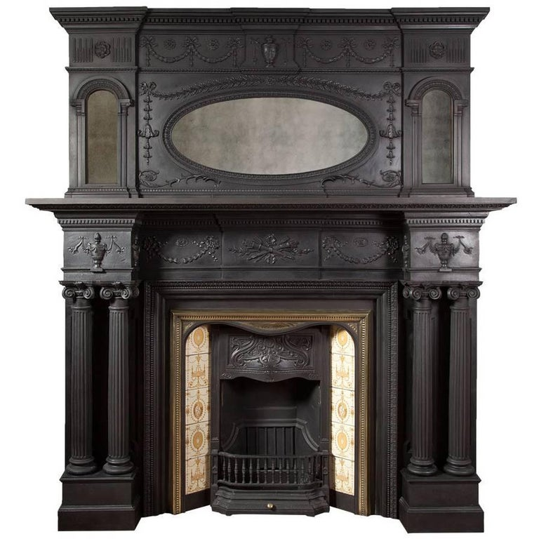 For Sale on 1stdibs - Large antique cast iron fireplace in the Georgian Adam revival style. Made by the renowned Coalbrookdale Foundry in 1880 to the highest of standards