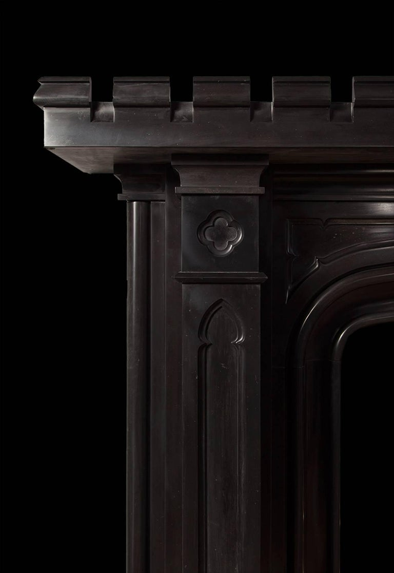 Black marble Gothic mantelpiece designed by Sir George Gilbert Scott for Preston Town Hall.