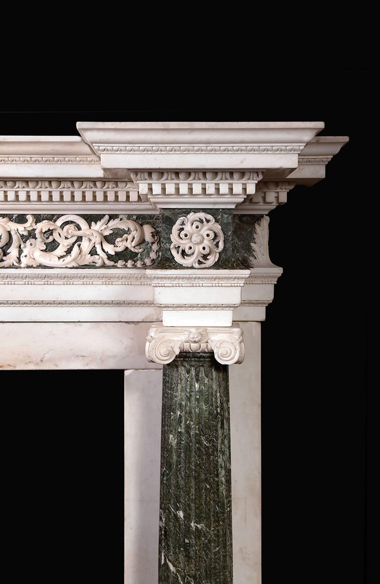 The frieze having curved panels of verde antico, overlaid with foliate scrolls of statuary marble. The centre plaque which is dog leg in shape depicts Flora, goddess of flowers and the season of spring, flanked by swags of oak leaves and acorns. The