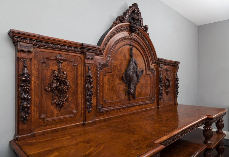 Large antique pollard oak sideboard of exceptional quality and great architecture form. This wonderful sideboard, server or buffet boasts exquisitely carved elements and eye-catching pollard oak veneers. The arch topped back is carved with a hunt