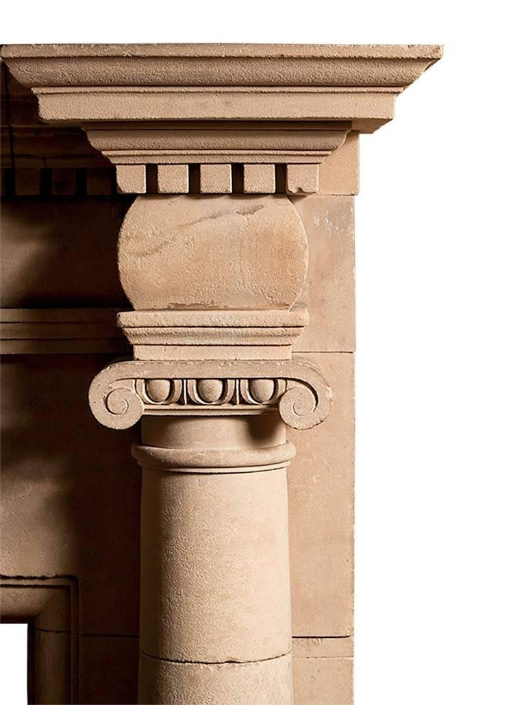 A superb and rare English Coade stone chimneypiece.  The engaged ionic columns support curved barrel end blockings and frieze panels, below these the key stone with the date of manufacture A 1829 D. The open pediment with dental detail rests upon