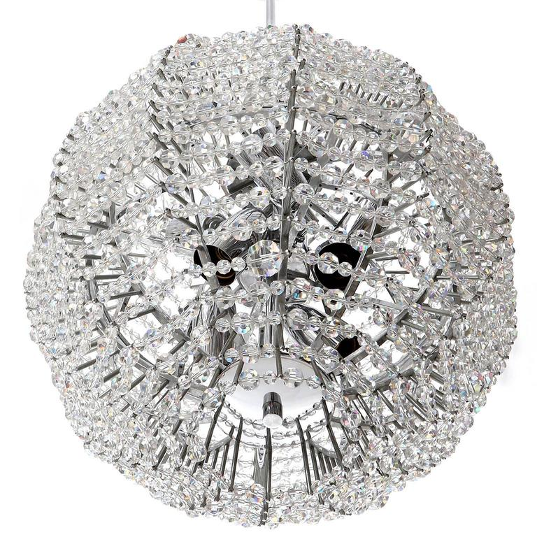 A rare and fantastic Supernova Sputnik chandelier by Bakalowits & Soehne, Austria, Vienna, manufactured in Mid-Century, circa 1960. A ball shaped nickel-plated brass frame is decorated with hundreds of hand-cut crystal glasses. The light takes eight