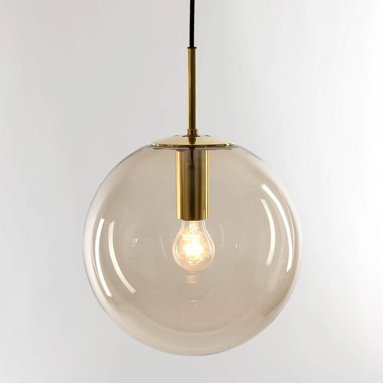 Charmant One Of Eight Limburg Globe Pendant Lights Brass And Smoked Glass In  Excellent Condition For Sale