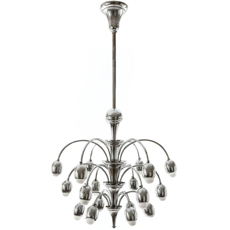 A large and stunning Art Deco chandelier, Austria, circa 1930. A nickel-plated brass frame with 18 arms and sockets for medium base screw bulbs (LED or filament). The light is in very good condition. It has been professionally cleaned and rewired