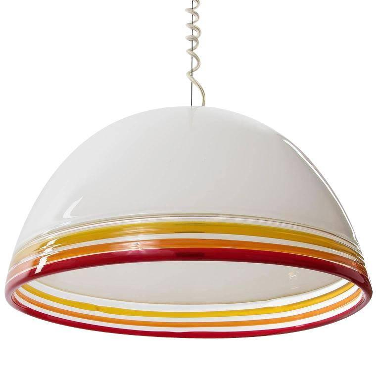 A pendant light fixture designed by Roberto Pamio and Renato Toso for Leucos, Italy, manufactured in Mid-Century, circa 1975. It is made of an opal white handblown Murano glass shade with three different colored (red, orange, yellow) rings. One