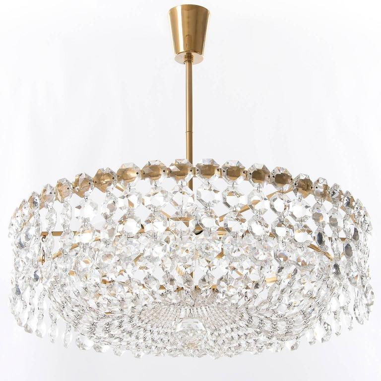 One of two very exclusive and high quality pendant chandeliers by Bakalowits & Söhne, Austria, manufactured in Mid-Century, circa 1960.  Each chandelier is made of a gold-plated brass frame decorated with hundreds of faceted glass crystals.  There