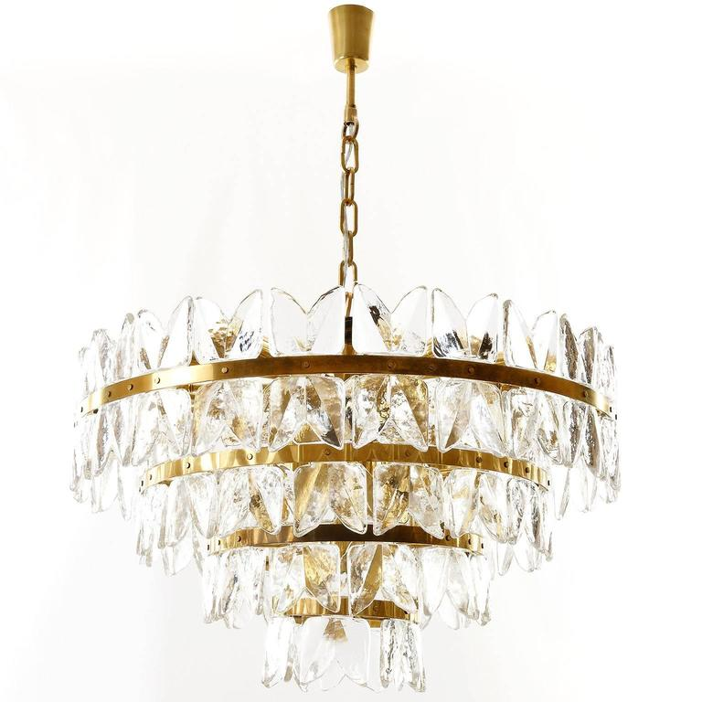 """A very exclusive and large ice glass chandelier or pendant light model """"Corina"""" by J.T. Kalmar, Vienna, Austria, manufactured in Mid-Century, circa 1970 (at the end of 1960s and beginning of 1970s).  An impressive handmade and high quality"""