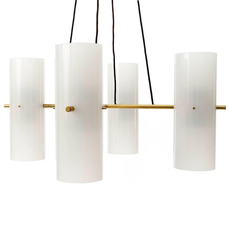 A rare pendant light fixture model no. 3768 'Vierzylinder' ('four-cylinder') by J.T. Kalmar, Austria, manufactured in Mid-Century, circa 1960 (late 1950s or early 1960s). A brass frame in the form of a cross with four cylindrical lamp shades made of