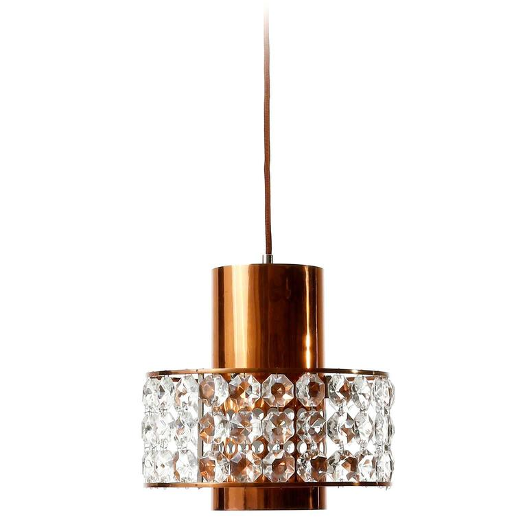 One of three fantastic lanterns or pendant lamps by Bakalowits und Söhne, Austria, Vienna, manufactured in Mid-Century, circa 1960. They are made of a nickel-plated brass and copper frame which is decorated with diamond cut crystal glass. There is