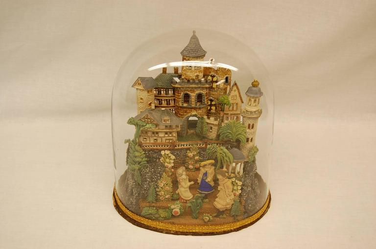 European castle, trees, bushes, people and crushed glass comprise this wonderful diorama under the original glass dome.