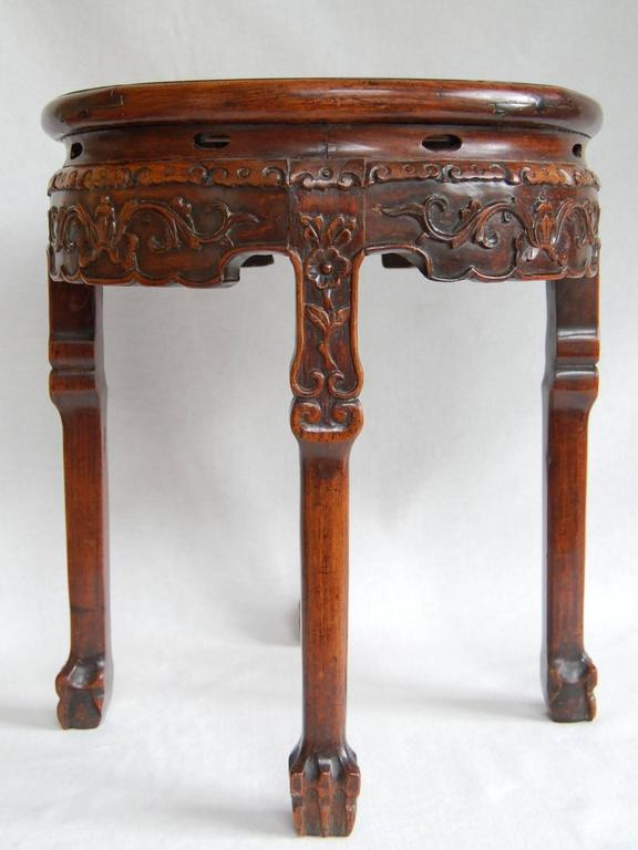 Late 19th century circular Chinese table with marble top. Excellent condition with beautiful color and patina.