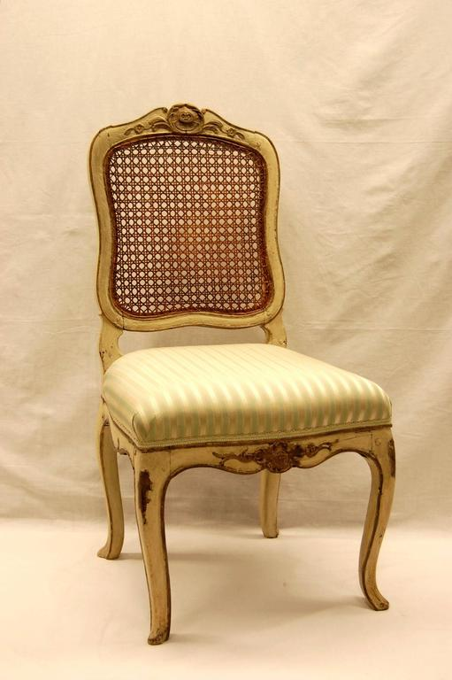 Italian version of a Louis XV type chair in original paint, likely Venetian, circa 1800. Covered in Scalamandre silk stripe, color: Celadon.