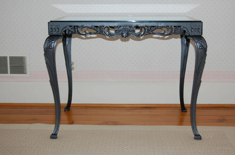 Beautiful cast iron table has just been powder coated in a dark gun metal finish.