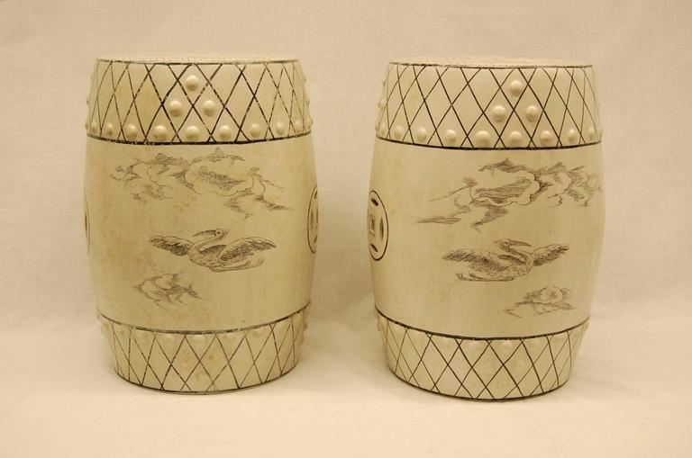 White glazed porcelain seats with scenes of hunting dogs attacking a boar, as well as birds flying. Excellent condition, age and origin unknown but likely, early 20th century.