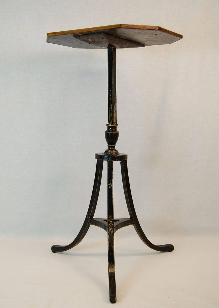 Mahogany hexagonal top with black painted and gold decorated tripod base, this is an original table, not a fire screen stand attached to a later top.