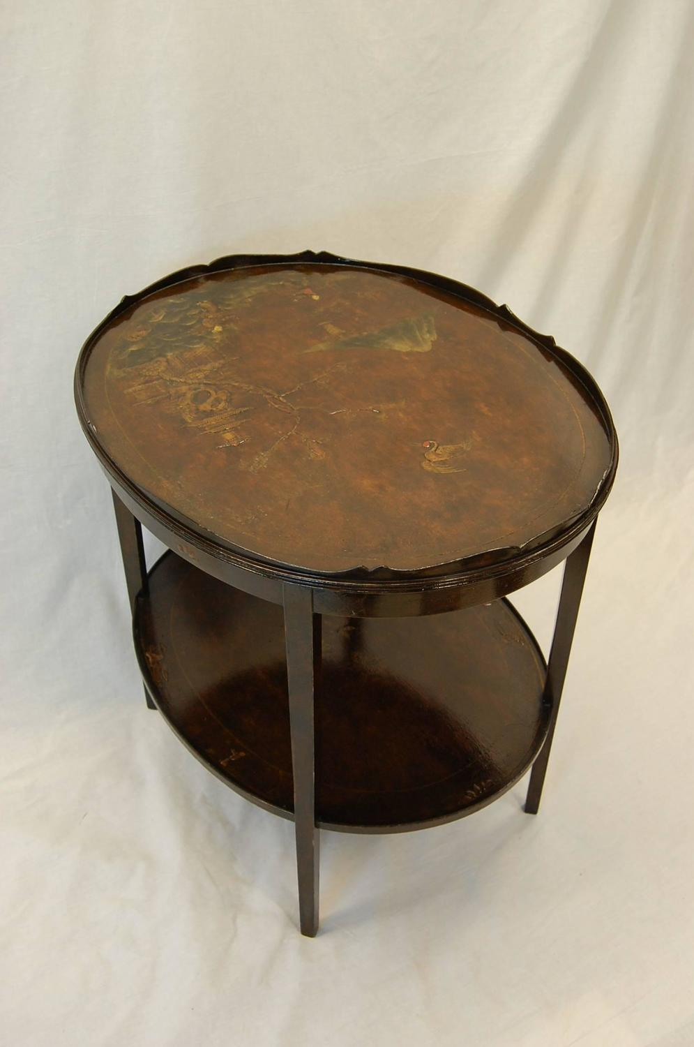 Chinoiserie decorated oval table with wood gallery and