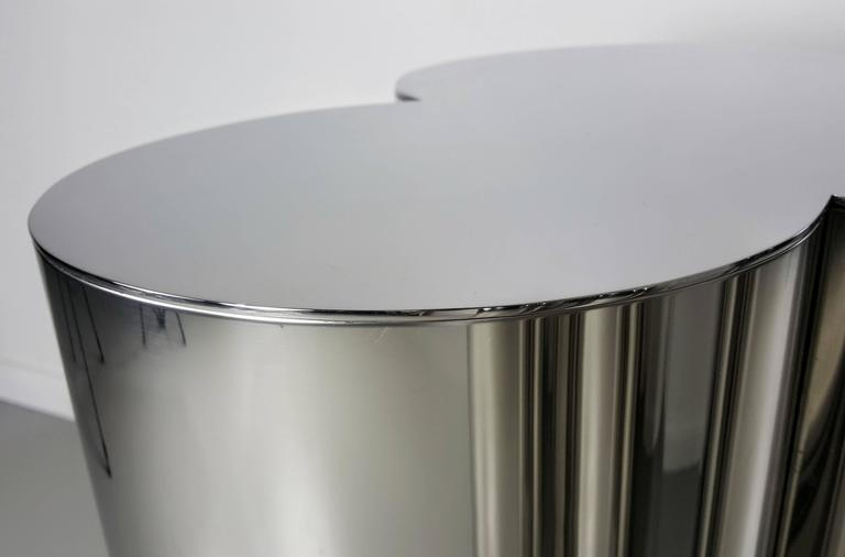 this custom trefoil dining table pedestal bases in mirror polished