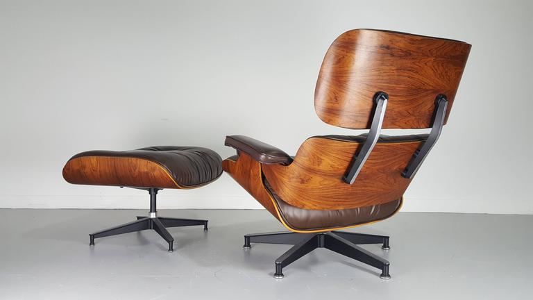 Iconic eames lounge chair and ottoman in brown leather and Iconic eames chair