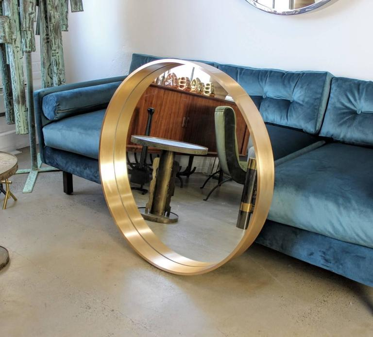"""Large round """"Oculus"""" mirror in solid bronze by Refine Limited. This monumental modern mirror is hand-forged in the USA and made with the highest quality craftsmanship and materials. Size shown here is 34"""" in diameter but can be"""